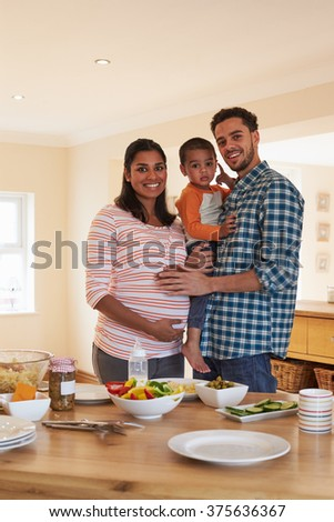 Portrait Of Family With Pregnant Mother And Young Son - stock photo