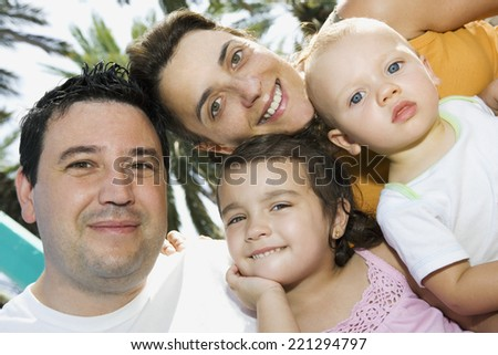 Portrait of family with two children - stock photo