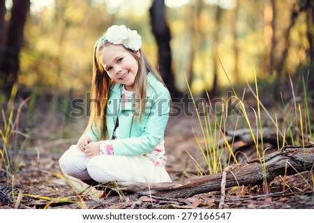 portrait of fashion little girl at autumn background - stock photo