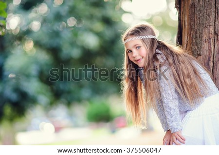 Portrait of fashion little girl with long hair - stock photo