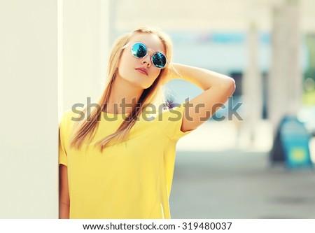 Portrait of fashion pretty blonde woman in sunglasses outdoors - stock photo