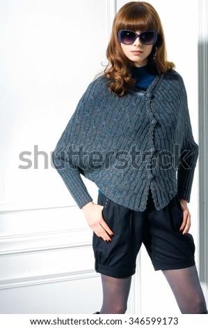 portrait of fashion shot of girl in near door standing posing  - stock photo