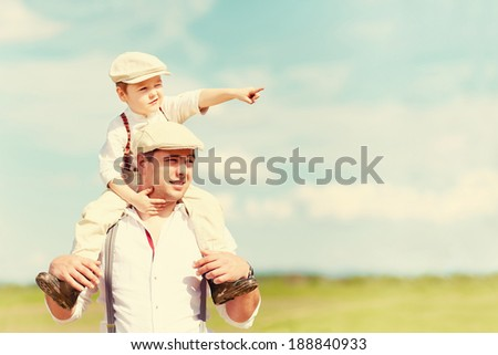 portrait of father and son in the countryside - stock photo