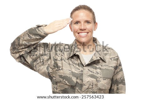 Portrait of female airman saluting against white background - stock photo