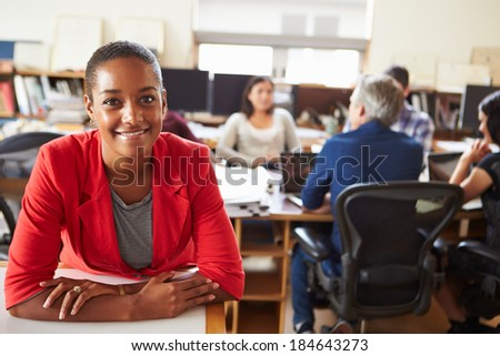 Portrait Of Female Architect With Meeting In Background - stock photo