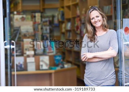 Portrait Of Female Bookshop Owner Outside Store - stock photo