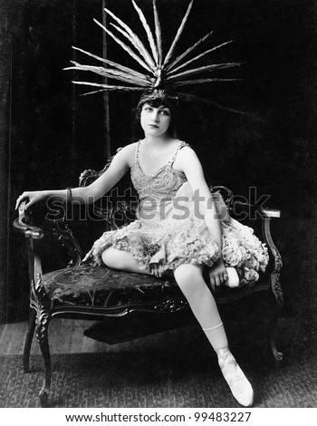 Portrait of female dancer with feather headdress - stock photo