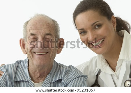 Portrait of female doctor with elderly male patient - stock photo