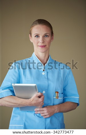 portrait of female doctor with  tablet computer at hospital - stock photo
