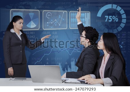 Portrait of female entrepreneur lead a business meeting and let her team member to ask - stock photo