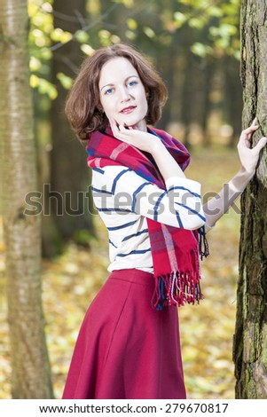 Portrait of Female Fashion Model Posing in Autumn Forest Outdoors.Vertical Image Orientation - stock photo