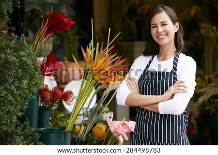 Portrait Of Female Florist Outside Shop - stock photo