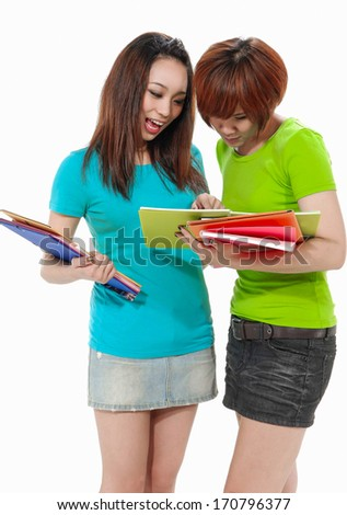Portrait of female friends holding notebook - stock photo