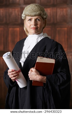 Portrait Of Female Lawyer In Court Holding Brief And Book - stock photo