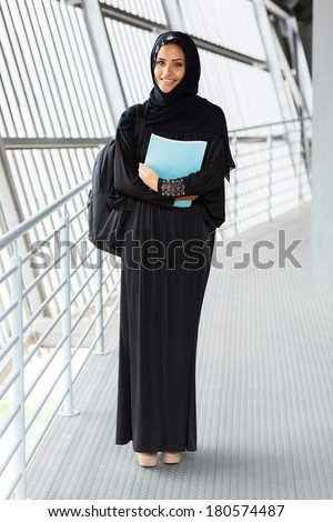 portrait of female muslim college student in traditional clothes - stock photo