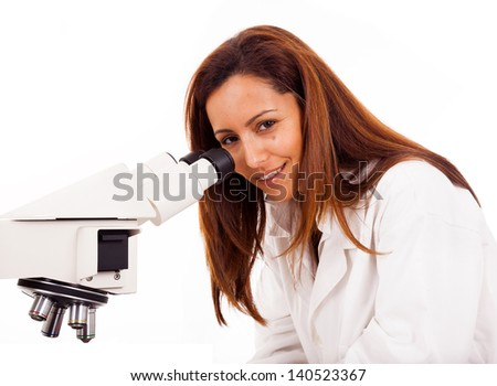 Portrait of female scientist working with a microscope, isolated on white - stock photo