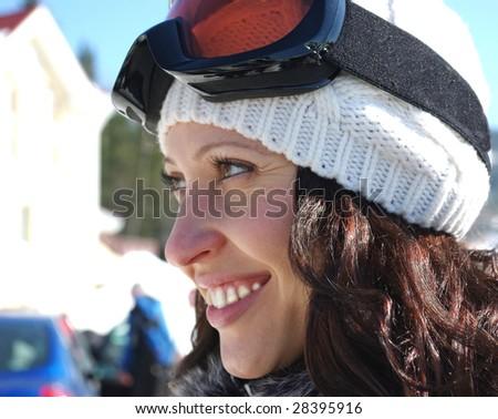 Portrait of female skier on ski resort - stock photo
