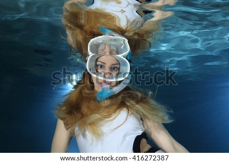 Portrait of female snorkeler underwater  - stock photo
