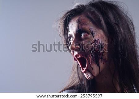 Portrait of female zombie/Zombie portrait - stock photo