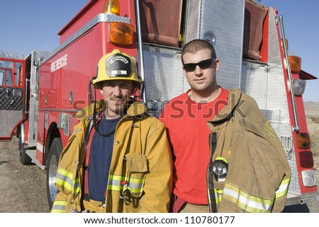 Portrait of firefighters - stock photo