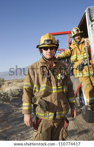 Portrait of firefighters on the road - stock photo