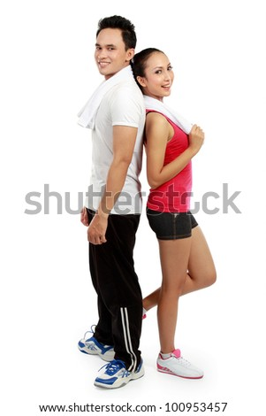 portrait of Fitness. Smiling young man and woman. Isolated over white background - stock photo