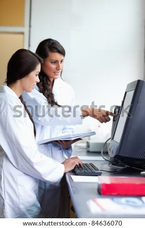 Portrait of focused scientist comparing results in a laboratory - stock photo