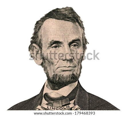 Portrait of former U.S. president Abraham Lincoln as he looks on five dollar bill obverse. Clipping path inside.  - stock photo