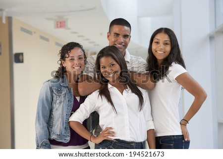 Portrait of four university students smiling - stock photo