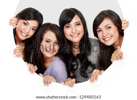 portrait of four  woman in circle hole - stock photo