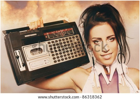 Portrait of freaky woman with a old fashioned tape recorder - stock photo