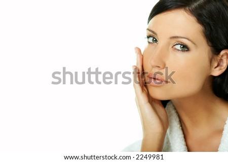 Portrait of Fresh and Beautiful brunette woman on white background wearing white bathrobe - stock photo