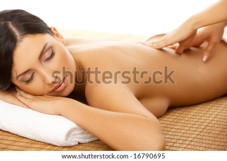 Portrait of Fresh and Beautiful brunette woman taking massage - stock photo