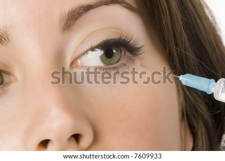 Portrait of fresh and beautiful woman getting a beauty injection - stock photo