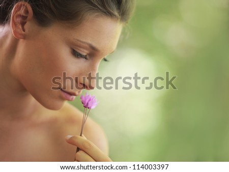 Portrait of Fresh and Beautiful woman with flower. Soft focus - stock photo