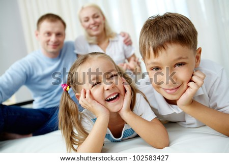 Portrait of friendly brother and sister looking at camera - stock photo