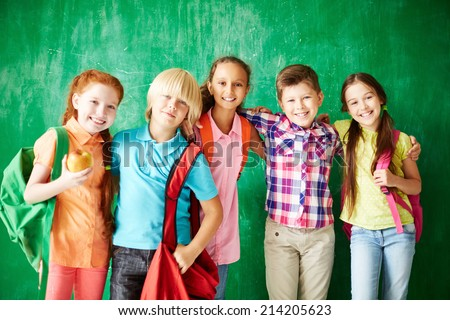 Portrait of friendly classmates looking at camera with smiles - stock photo