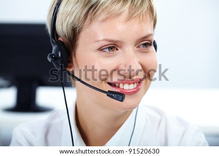 Portrait of friendly customer service representative smiling - stock photo