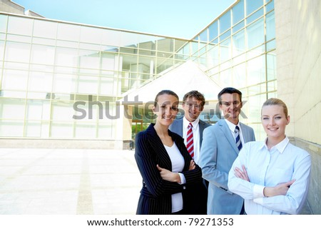 Portrait of friendly partners looking at camera outside - stock photo