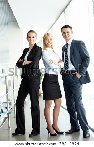 Portrait of friendly three business people looking at camera - stock photo