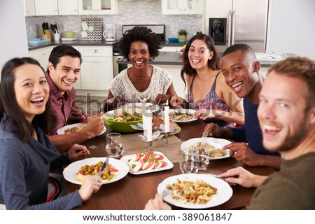 Portrait Of Friends Enjoying Dinner Party At Home - stock photo