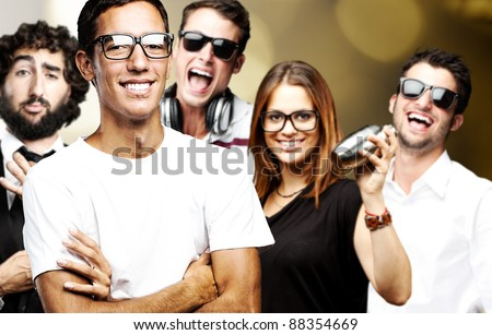 portrait of friends group smiling and joking against a abstract background - stock photo