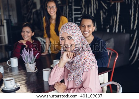 portrait of friends having fun together in a cafe. looking at camera - stock photo
