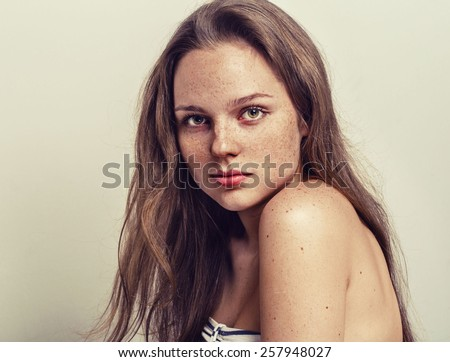 Portrait of fun attractive girl woman with freckles clear skin and beautiful hair hipster - stock photo