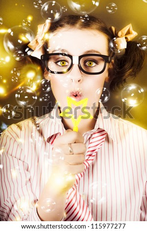 Portrait Of Fun Nerd Business Woman Blowing Soap Bubbles Through A Star In A Depiction Of Business Success - stock photo