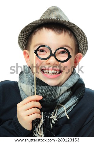 Portrait of funny boy with party glasses on white background - stock photo