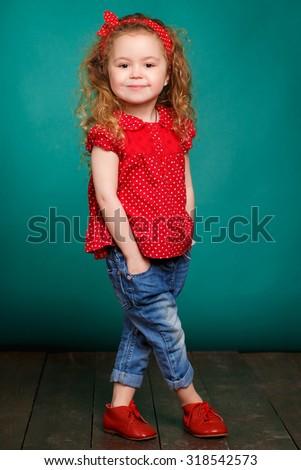 Portrait of funny lovely little girl. Cute little girl on green background. child girl. funny kid studio portrait - stock photo
