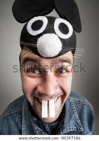 Portrait of funny man in rabbit hat - stock photo