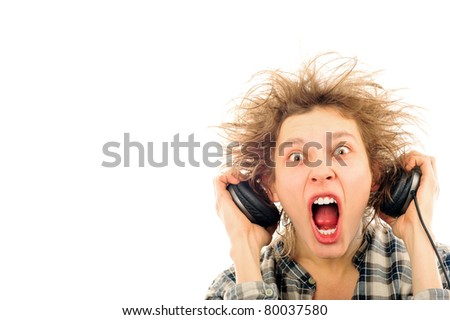 Portrait of funny young man with awesome hairdo isolated on white background. Listening music using headphones - stock photo