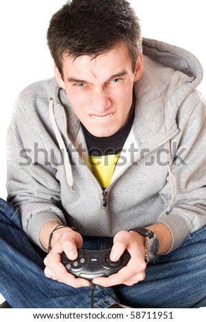 Portrait of furious young man with a joystick for game console - stock photo